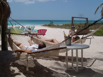 Relaxing on the beach at Cedar Cove Resort & Cottages.