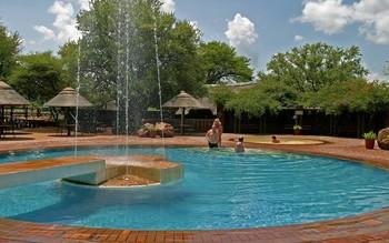 Manyane Resort pool at Golden Leopard Resorts.
