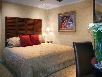 Guest bedroom at The Chateau Inn & Suites.