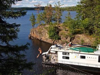 Going down houseboat slide at Ebel's Voyageur Houseboats.