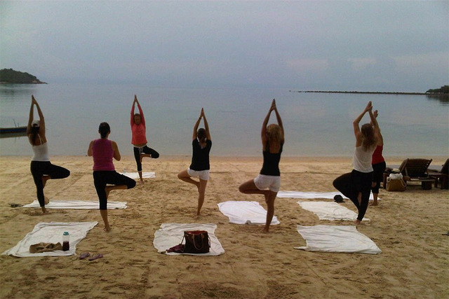 Yoga on the beach at Taboo Resort.