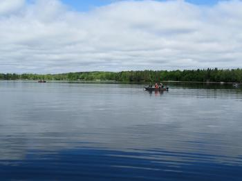 Boating on the lake at Two Inlets Resort.