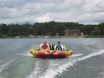 Tubing on lake at Cozy Bay Resort.