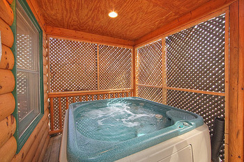 Outdoor whirlpool in vacation home at American Patriot Getaways, LLC.