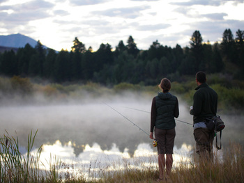 Couple fishing at South Fork Lodge.