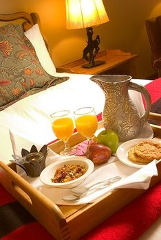 Breakfast In Bed at Rusty Parrot Lodge