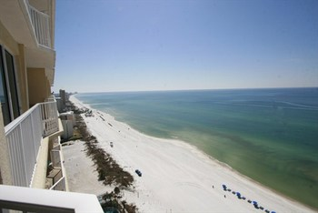 The beach at Resort Collection Vacation Rentals.