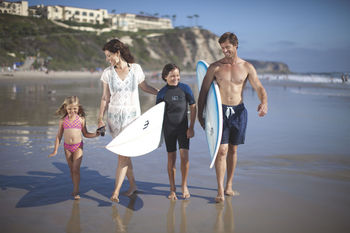 Family on beach at The Ritz-Carlton, Laguna Niguel.