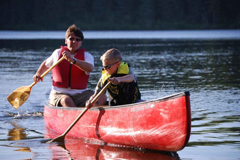 Canoeing at Woodland Estate Resort.