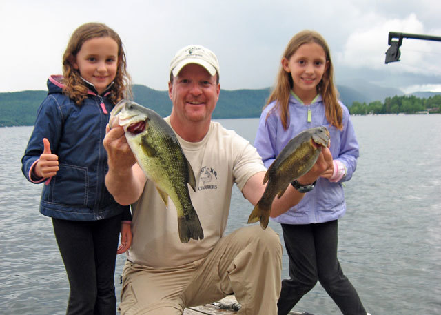 Family fishing at Northern Lake George Resort.