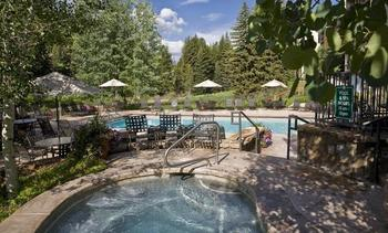 Outdoor pool and hot tub at Lion Square Lodge.