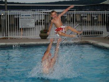 Kids swimming at Kapilana Resort.