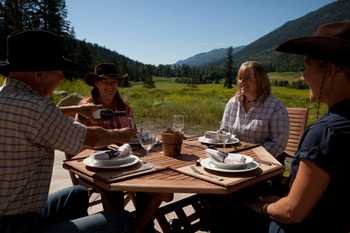 Outdoor dining at Tod Mountain Ranch.