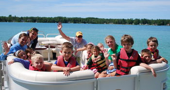 Family boating at White Birch Lodge.