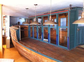 Boat inside house at Boat House Inn.