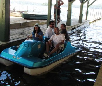 Family paddle boating at The Depe Dene Resort.
