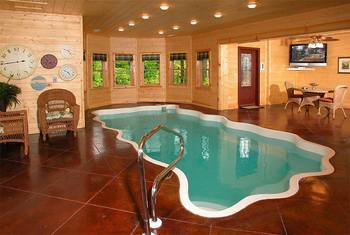 Cabin indoor pool at Timber Tops Luxury Cabin Rentals.
