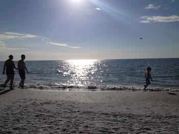 Family on the beach at Gulfview Manor Resort.