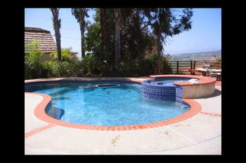 Outdoor pool at Vista Bed & Breakfast.