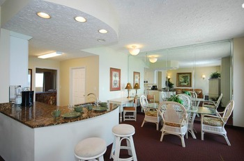 Guest room dining area at Legacy by the Sea.