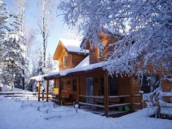 Cabin  in Winter at Timber Trail Lodge & Resort