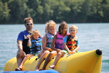 Family on banana boat at East Silent Resort.