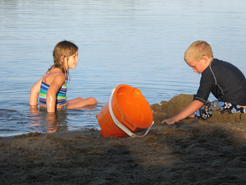 Kids playing on the beach at Half Moon Trail Resort.