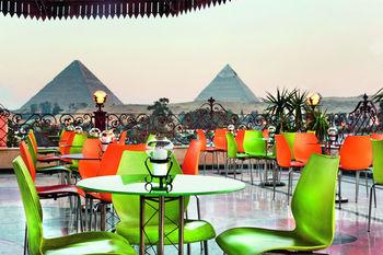 Patio dining at Mövenpick Cairo-Pyramids Resort.