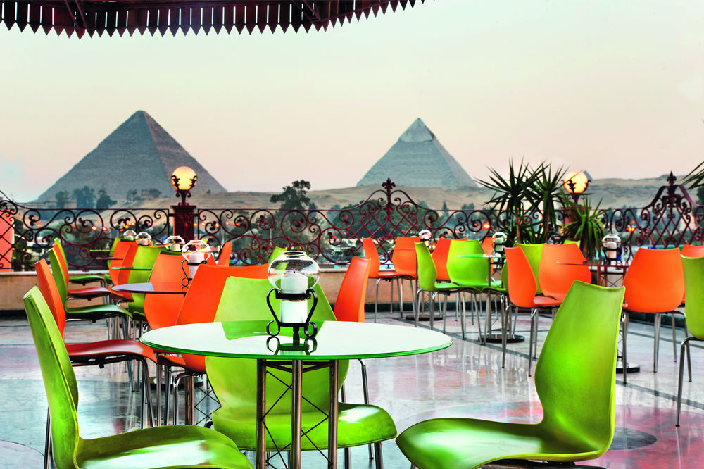 Patio dining at Mövenpick Cairo-Pyramids Resort.