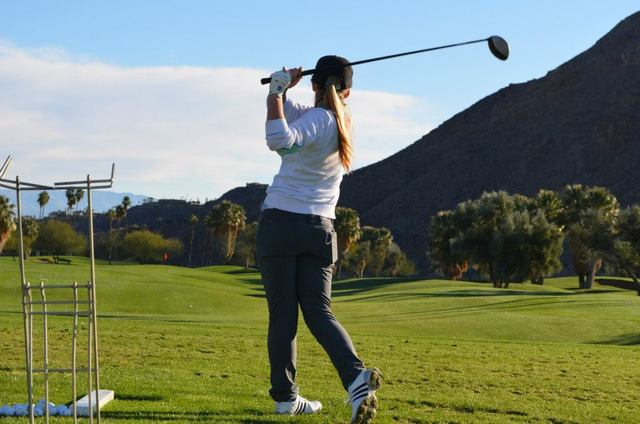 Playing golf at Indian Canyons Golf Resort.