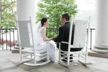 Wedding couple on the porch at The Otesaga Resort Hotel.