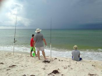 Fishing on the beach at Perdido Key Resort Management.