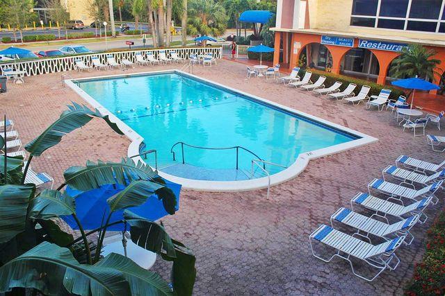 Outdoor pool at Knights Inn Hallandale Beach.