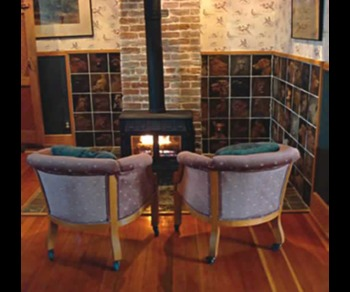 Relax by the fire at Abe's Spring Street Guest House.
