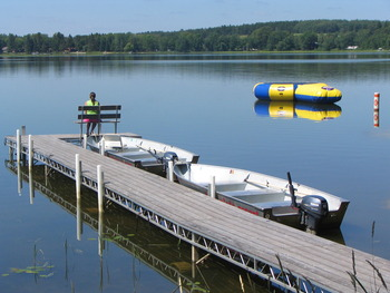 Quality docks with benches at Two Inlets Resort.