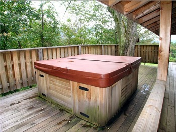 Cabin hot tub at Golden Anchor Cabins.