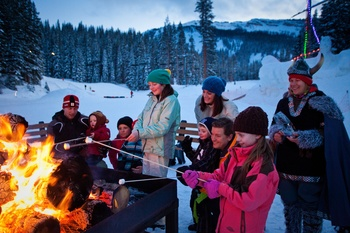 Family by bonfire at The Westin Snowmass Resort.