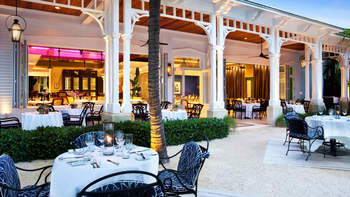 Outdoor patio at Sunset Key Guest Cottages, a Luxury Collection Resort.