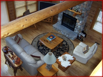 This home is a golfer's dream. This log home is located on signature hole 10 of the Hawk's Eye Golf Course. Offering 3 bedrooms and 3 baths, this home offers plenty of room for a large family or gathering of friends. The large open living room with gas fireplace with the spacious kitchen and dining area present the perfect environment for entertaining. The best part of the house - the lower level features a golf room with swingscape and putting greens.  Right outside the golf room is the media room with bar featuring a flatscreen TV and comfy recliners. The view from the home is breathtaking. Enjoy spending time on the upper and lower decks while watching the golfers go by.