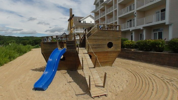 Children's playground at The Cherry Tree Inn & Suites.