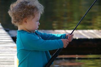 Fishing on dock at Pine Vista Resort.