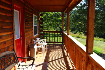 Relax on your cabin porch at Ozark Cabins.