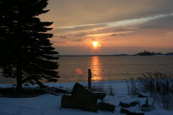 Sunset over Lake Superior at Cobblestone Cove Villas.