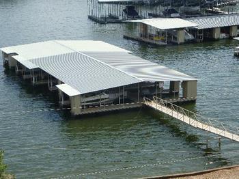 Covered docks at Kapilana Resort.