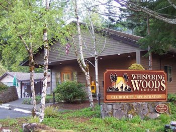 Exterior view of Whispering Woods Resort.