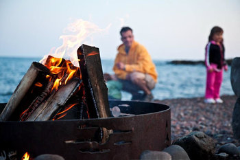 Bonfire on beach at Bluefin Bay on Lake Superior.