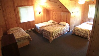 Cabin bedroom at Woodland Beach Resort.
