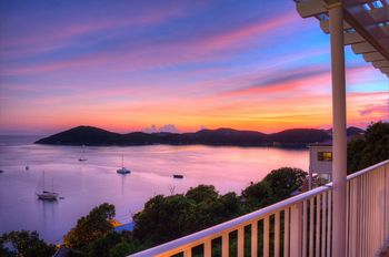 Balcony sunset at Bluebeard's Castle Resort.