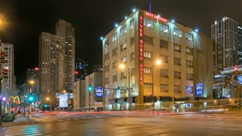 Exterior view of Best Western River North Hotel.
