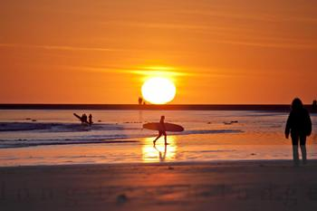 Surfing by sunset at Long Beach Lodge Resort.